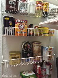 Wire rack above holds tea, coffee and baking ingredients