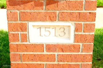 Faded house number