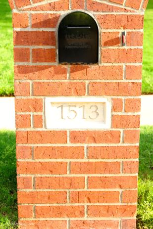 Faded house numbers on mail box