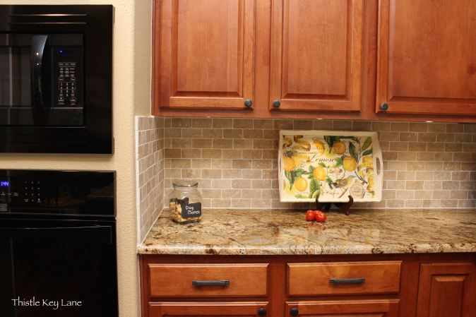 Kitchen with granite and tumbled