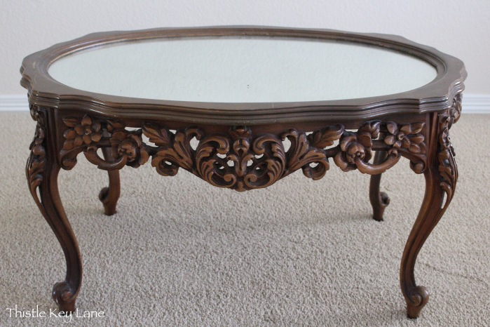 Carved mirror table