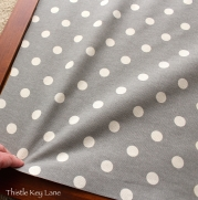 Pull fabric for a tight fit before stapling into place