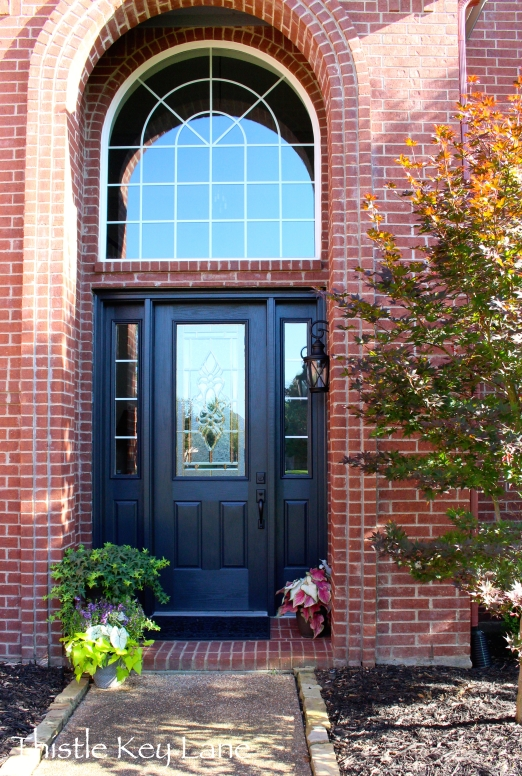 Plants add additional curb appeal to the freshly painted door