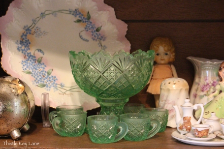 Green pressed glass miniature punch bowl and cups