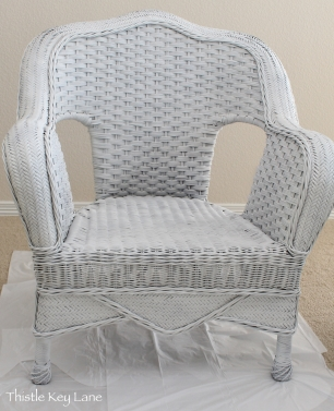 Wicker chair after spray paint + primer. Ready for next step.