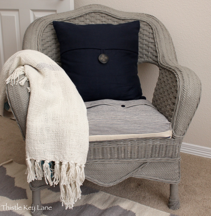 Wicker chair after paint update and a slip covered cushion.
