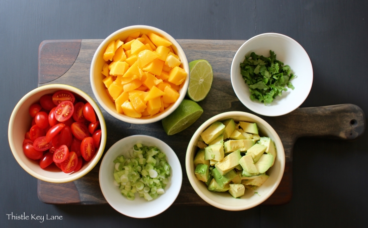 Mango, tomatoes, green onions, avocado, cilantro, lime juice, champagne vinegar and olive oil
