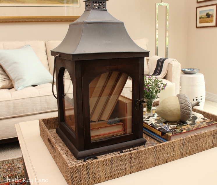 Pottery Barn lantern with books.