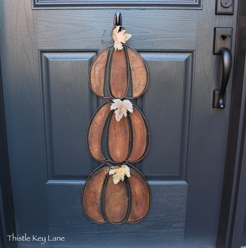 Stacked pumpkin door hanger with rustic finish