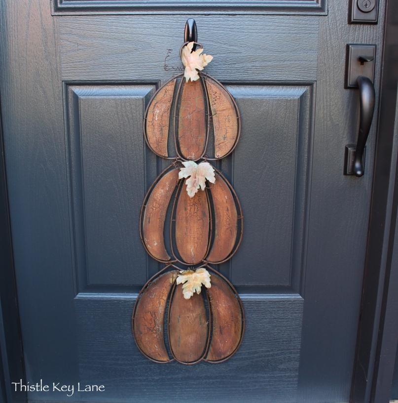Stacked pumpkin door hanger with rustic finish