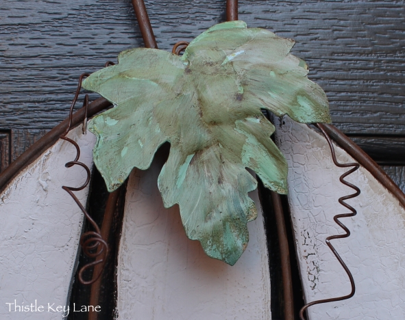 Leaves painted to resemble weathered copper