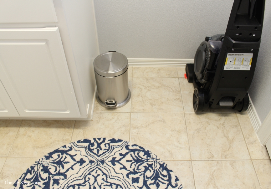 Storage behind the door for steam vac and trash can