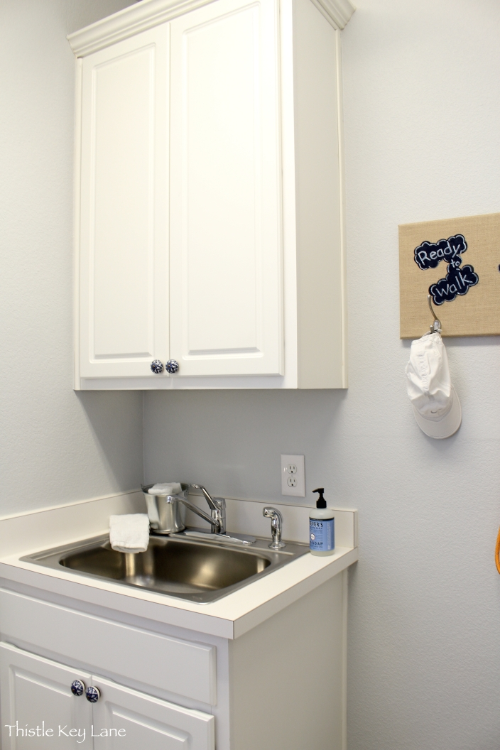 View the sink and cabinets with new hardware