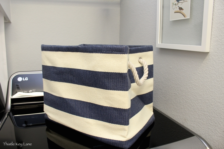 Blue and cream basket with rope handles from Container Store