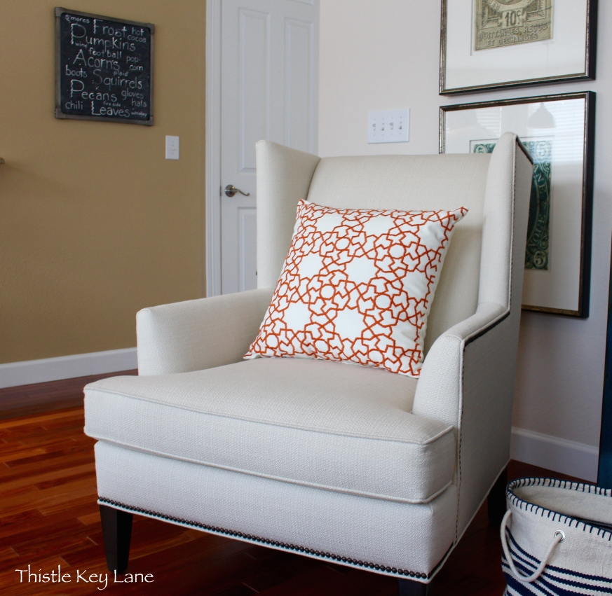 Cream wing back chair with Pottery Barn pillow