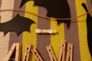 Double sticky dots used to attach clothes pins to paper bats