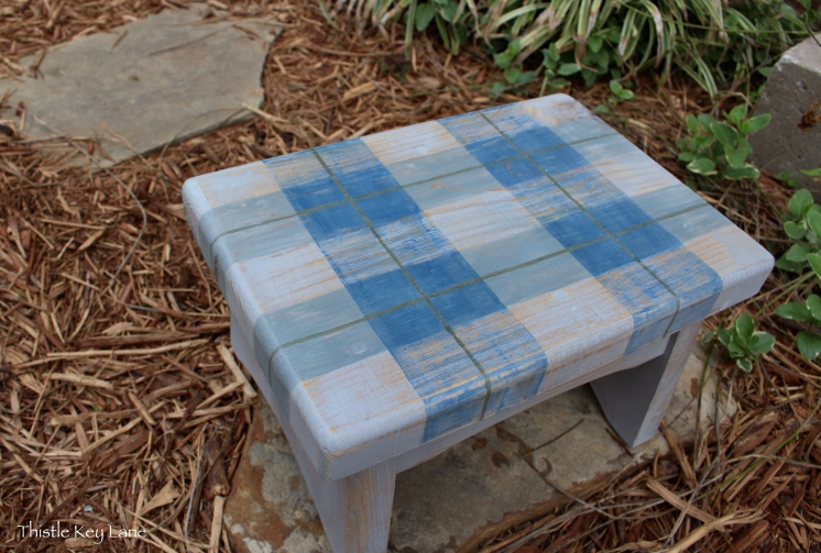 Charming plaid step stool with colors that are carefree and relaxed.