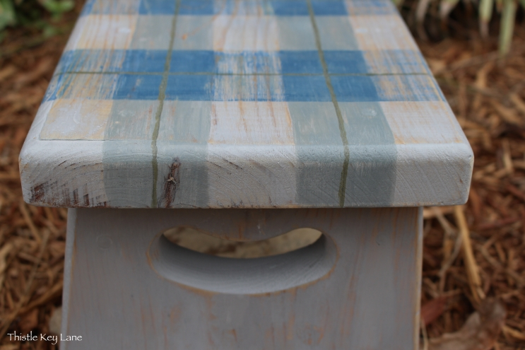 Wood grain and knots add personality to the step stool