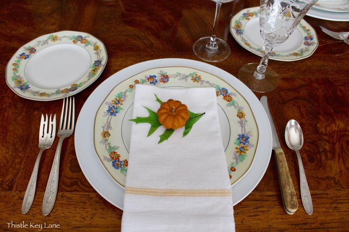 Placing the napkin on the dinner plate is a more casual approach.