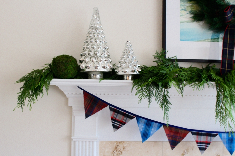 Decorating the mantle adding one element at a time