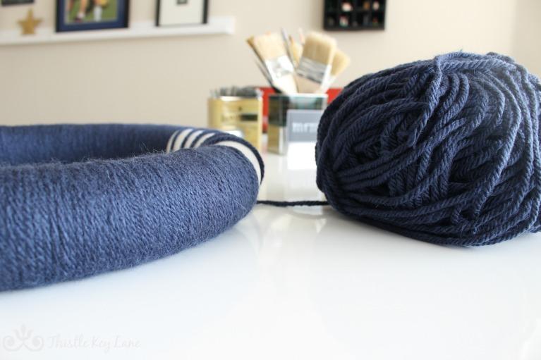 Wrapping yarn around the wreath