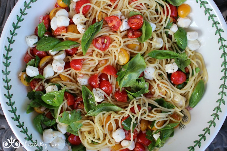 Combine tomatoes, herbs and spaghetti in a large serving bowl