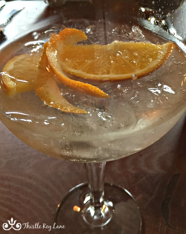 Crossbill Gin with a splash of tonic water and garnished with orange slices