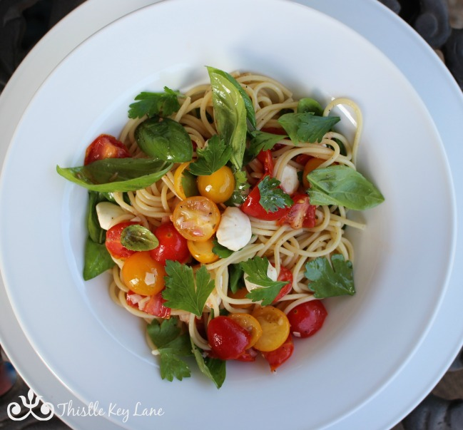 Fresh and yummy spaghetti with marinated tomatoes and mozzarella