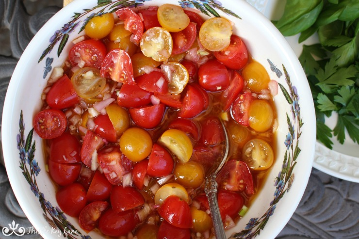 Occasionally stir the marinated tomatoes