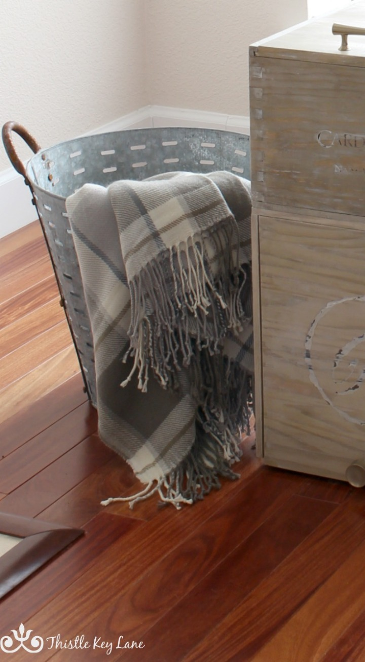 Plaid throw from Pottery Barn next to a wine crate end table.
