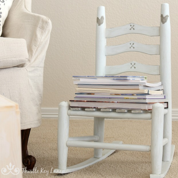 A child chair used for stacked books.