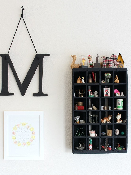 Gallery wall with miniatures in a crate