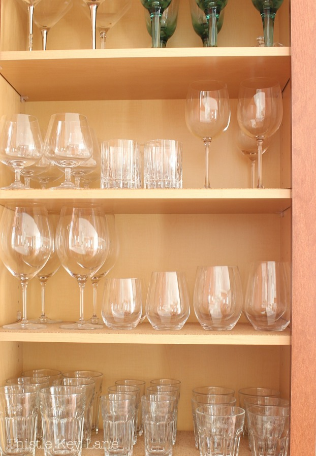 Organizing a kitchen with glassware.