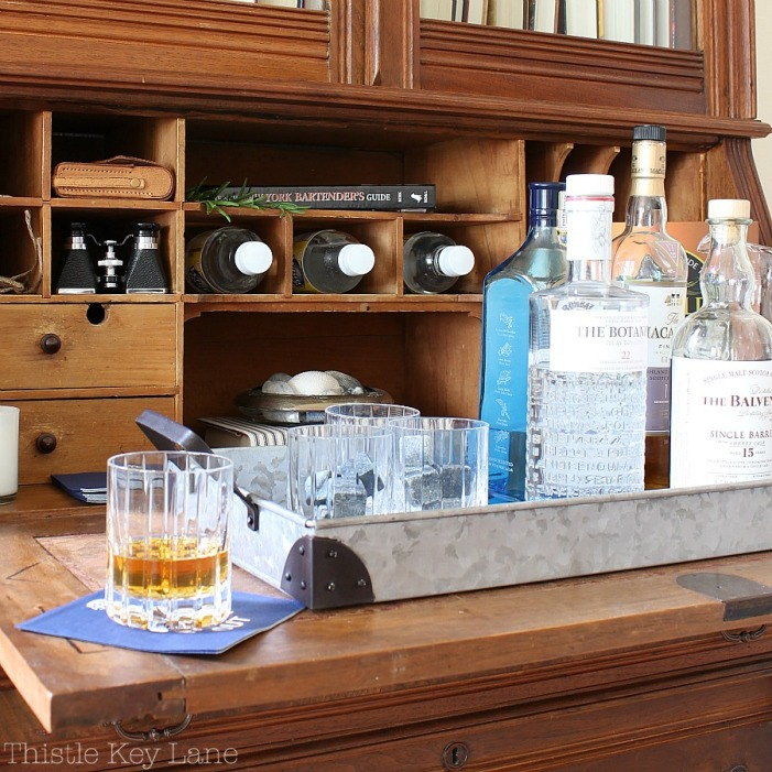 Galvanized tray help create a quick bar.