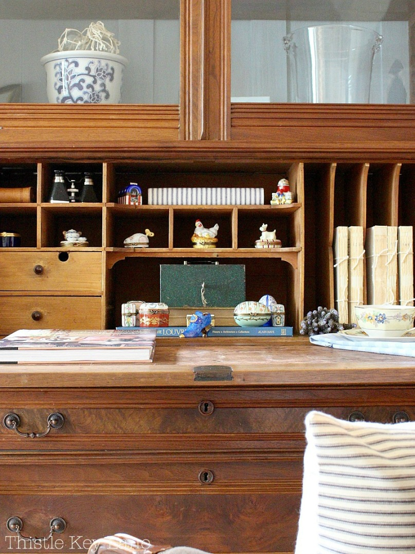 Style a secretary with a collection of Limoges boxes.
